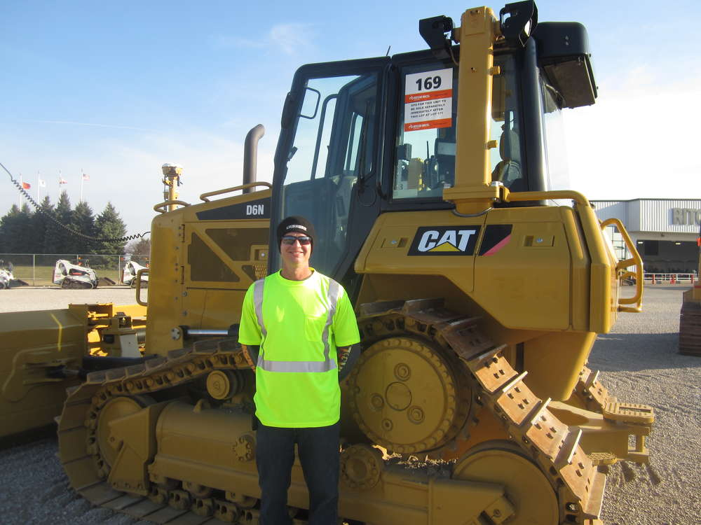 Todd Nobles of Plote Construction Inc. inspects some of the equipment the company had up on the block.