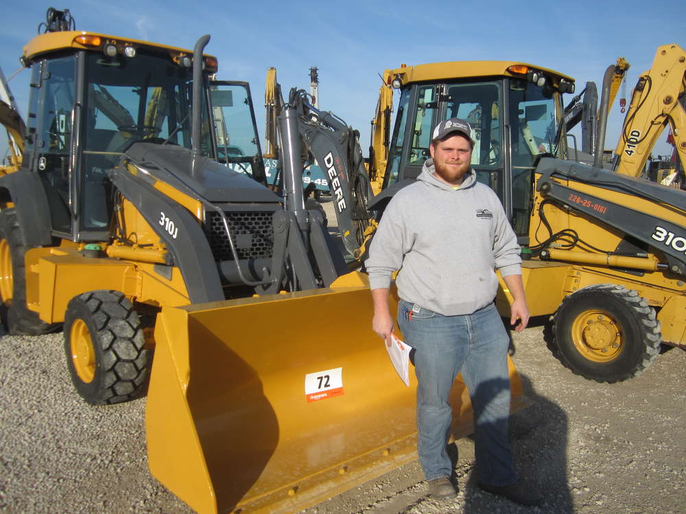 Ty Sparrow of Dirt Works Drainage and Excavating attends the sale.