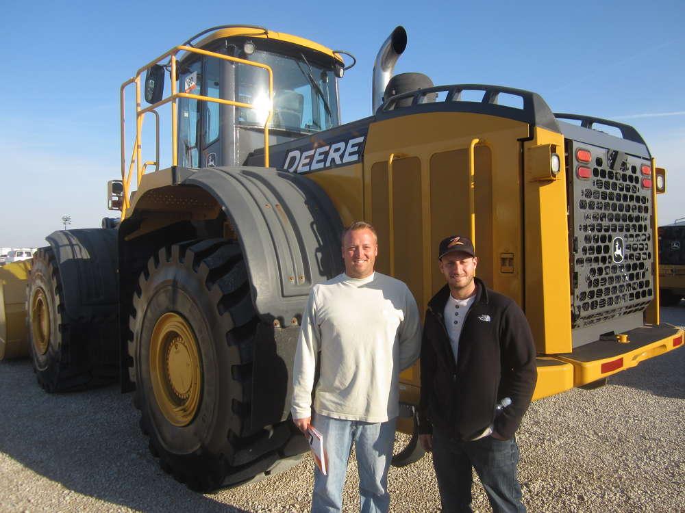 Tony (L) and Caleb Loniewski, both of E&L Paving, consider purchasing this late-model John Deere 844K wheel loader.
