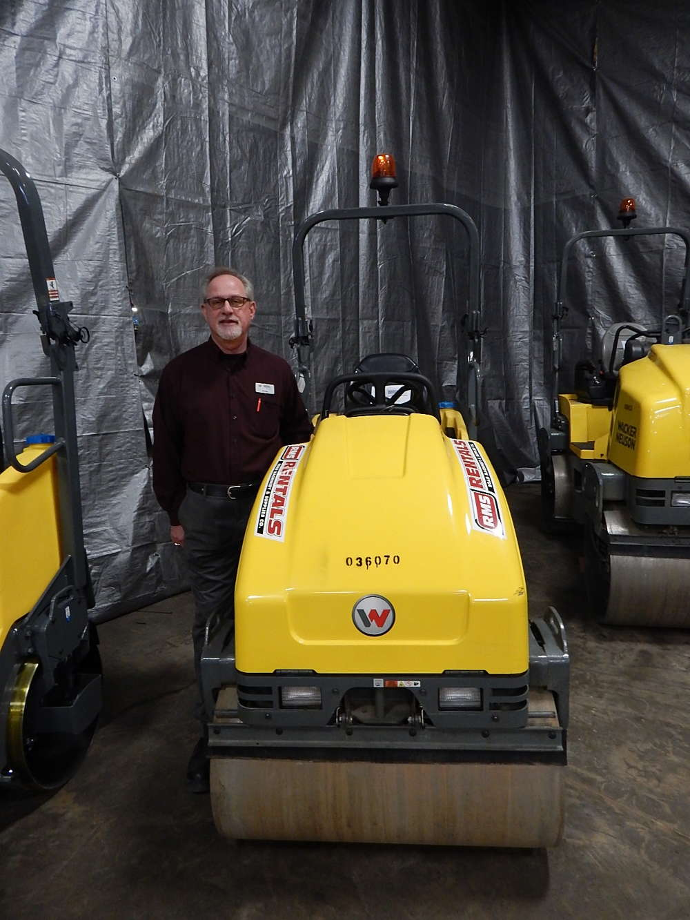 Al Voeltz, Wacker Nueson district territory representative, stands with a RD16-100 diesel asphalt roller at the RMS Rentals annual open house.