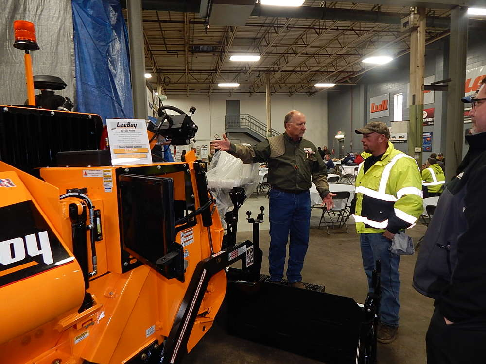 Tim Rients (L), sales representative of RMS Rentals, Savage, Minn., goes over the features of this new LeeBoy 8515D paver with a Tier IV Kubota engine with Ty Forner, operator of Custom Surfacing LLC, Sauk Rapids, Minn.