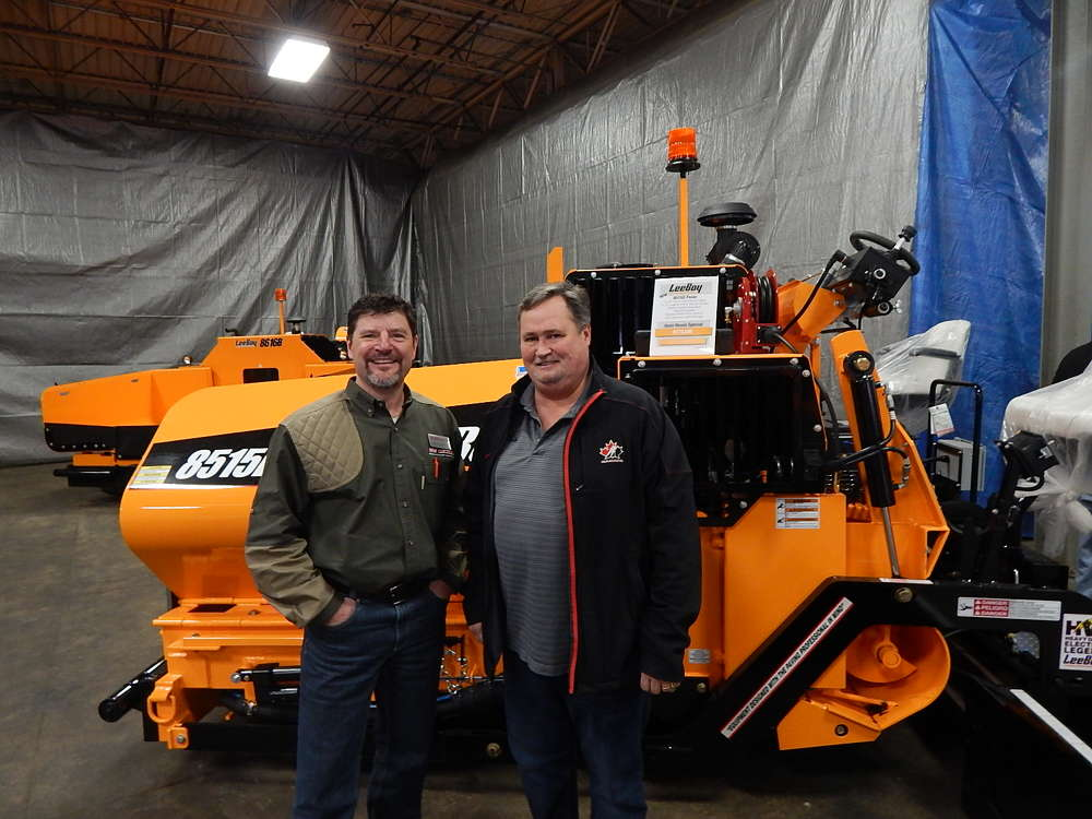 Brian Gaul (L), parts manager of RMS Rentals, and Erik Holmes, sales manager, ACE Asphalt, Osseo Minn., inspect this LeeBoy 8515C paver.
