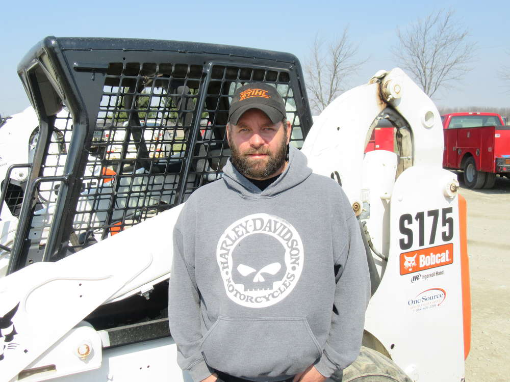 James Headley of Headley Tree Service, looks at skid steers, but said he was interested primarily in the chippers on sale at the auction.