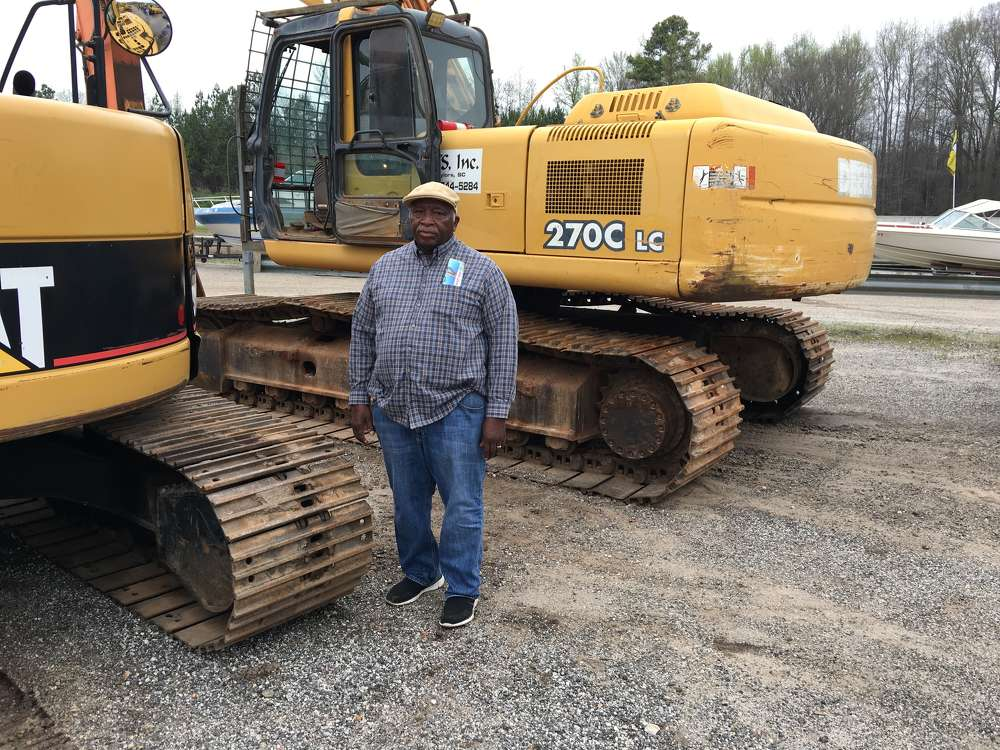 Bobby Spurgeon, Bobby Spurgeon Grading, Piedmont, S.C., looks over the John Deere 270C LC excavator.
