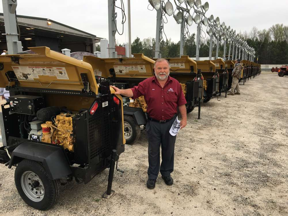 Joey Moore, Joe's Tractor Sales, Thomasville, N.C., shops the selection of 20 Allmand light towers.