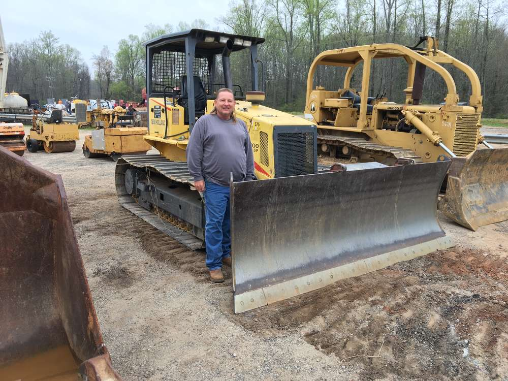 Randy Bailey of Bailey's Recycling in Pelzer, S.C., inspects this New Holland DC100LGP dozer.
