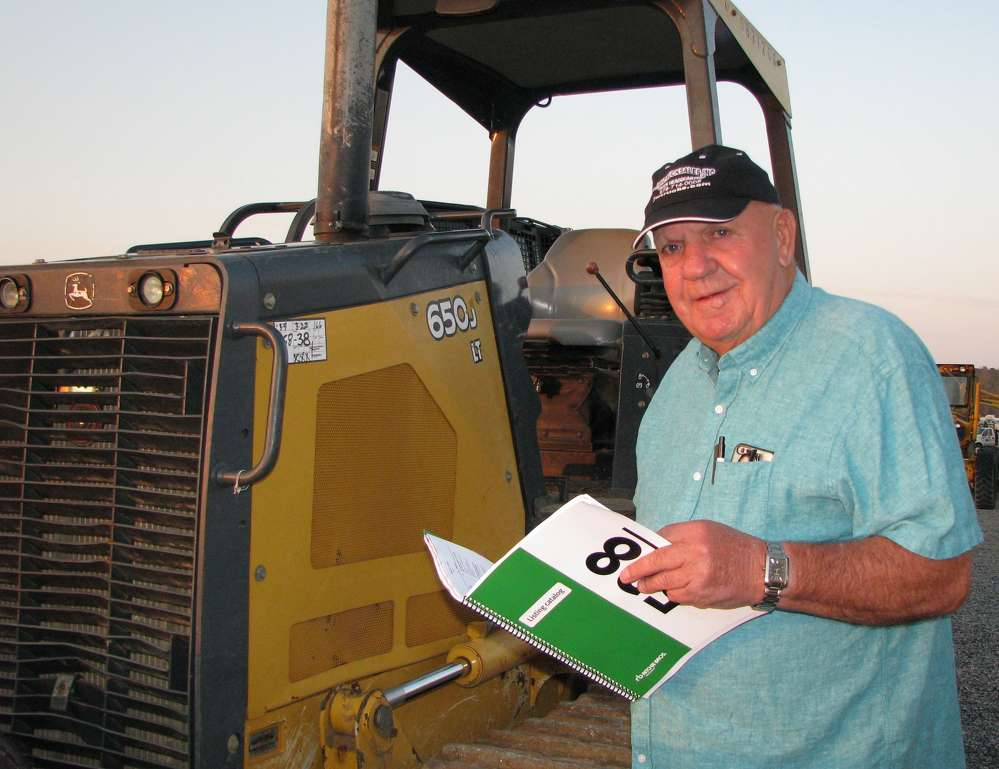 James Wimpey of J.W. Truck Sales, Sugar Hill, Ga., looks over this John Deere 650J dozer.