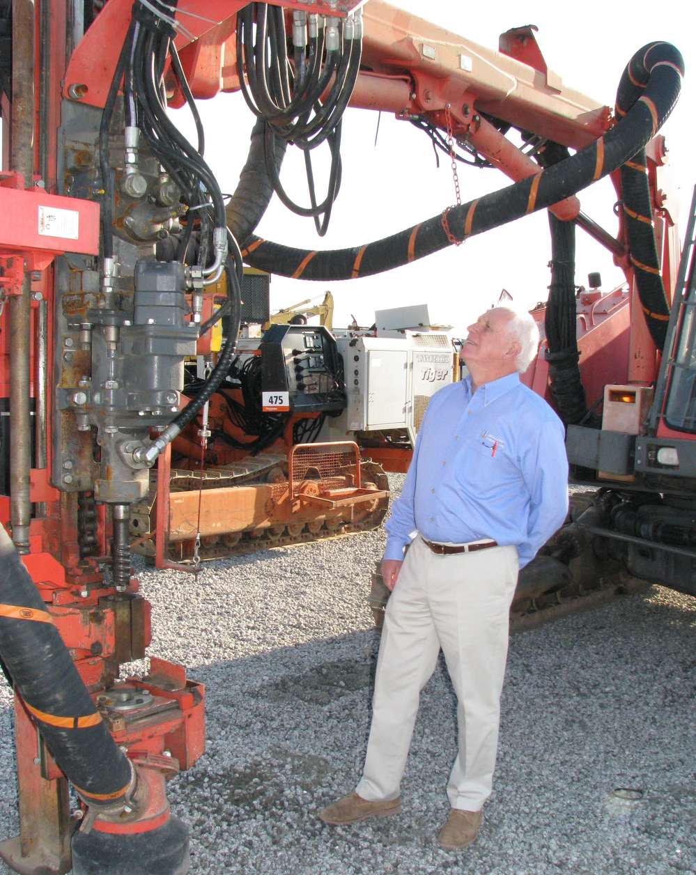 Allen Cellar of Drillers' Choice, Marietta, Ga., looks over a Sandvik DX800 drill in the sale lineup.