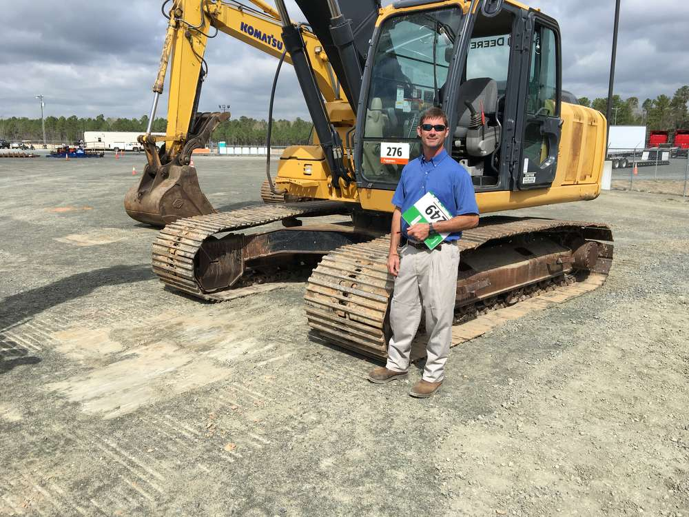 Scott Tulloss of Tulloss Equipment in Rocky Mount, N.C., shops the selection of excavators.