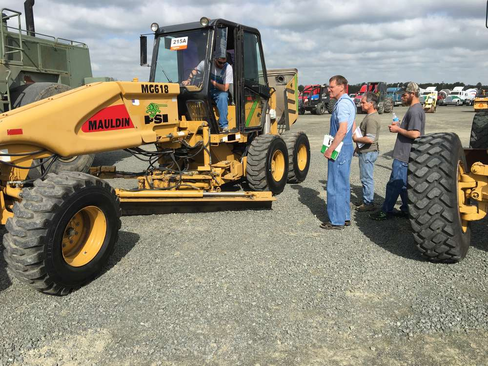 This Mauldin MG618 motorgrader attracts attention at the sale.
