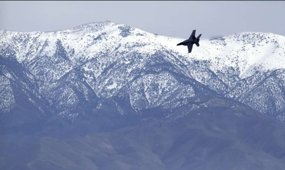 Pilots perform barrel rolls and other maneuvers while navigating the canyon in Death Valley National Park. (AP Photo/Ben Margot)