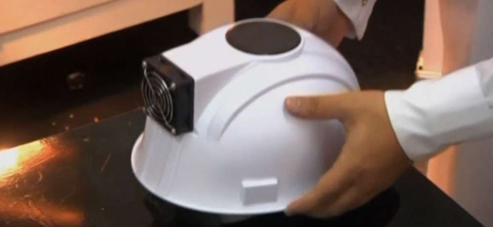 The solar-powered hat would reduce body heat by 10 degrees centigrade according to the engineering group that created them in Qatar. Reuters photo.