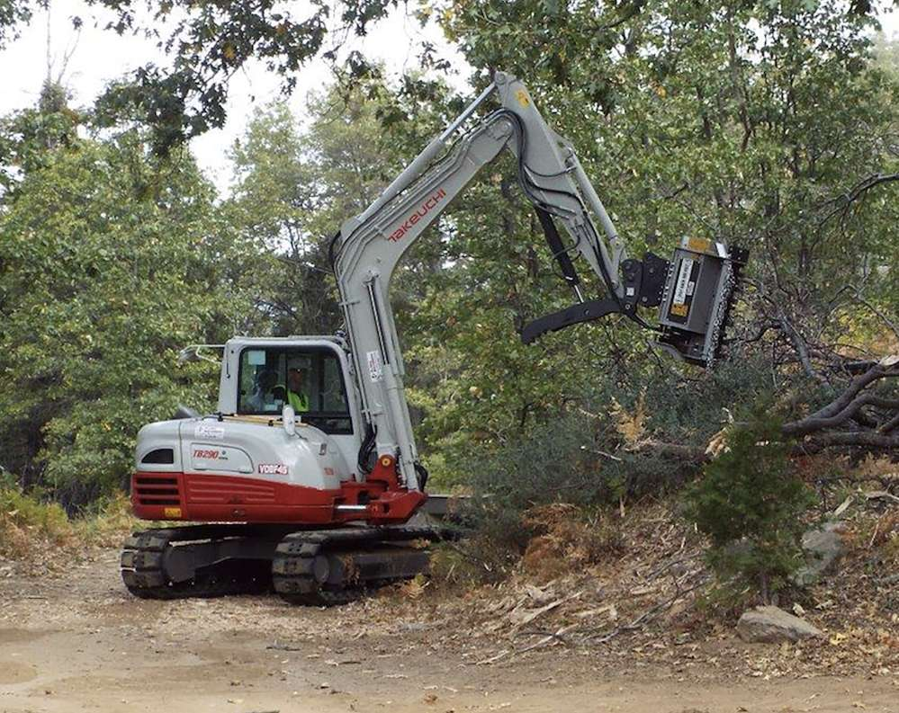 At Shaver Lake and Big Bear, the TB290 was used to masticate an overstory of mixed conifer, with extensive cover of manzanita with whitethorn, dogwood and black oak, with diameters of 3 to 6 in. (7.6 to 15.2 cm) and slopes up to 40 percent.