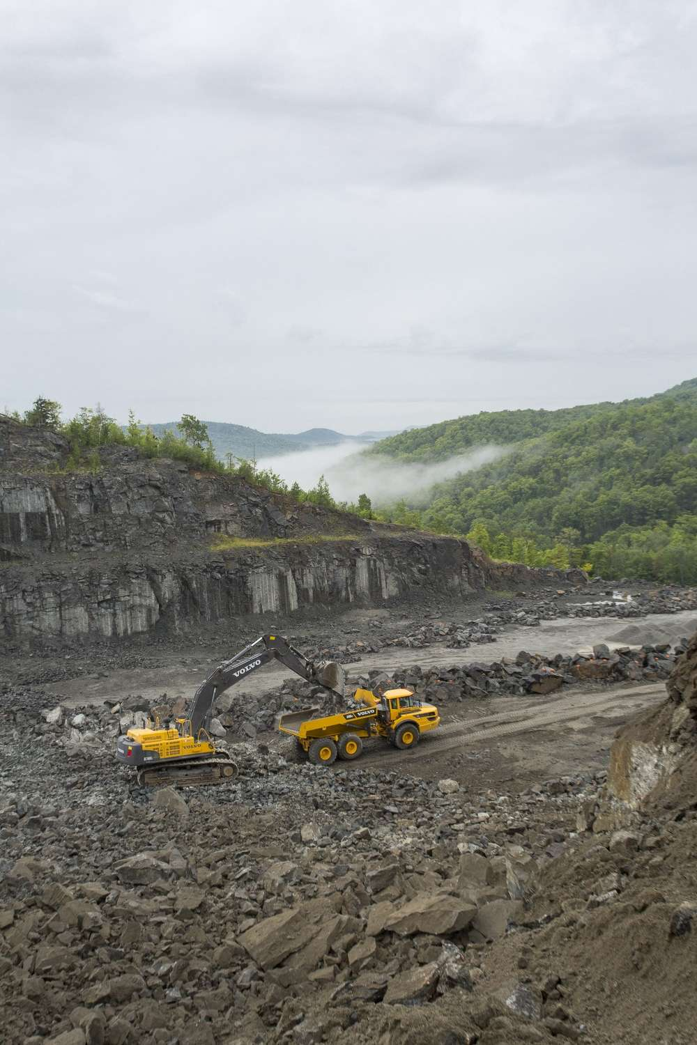 A Volvo excavator and articulated hauler work together on the Barton mine.