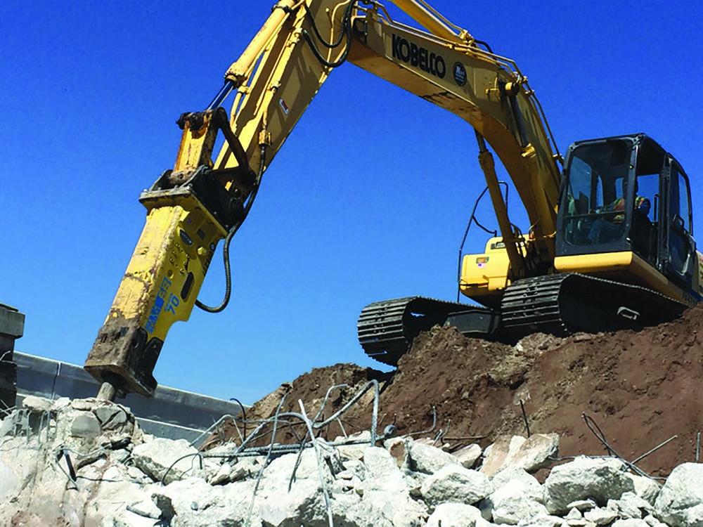 Soosan SB70 TS-P works on highway demolition at Disney's Epcot Park.