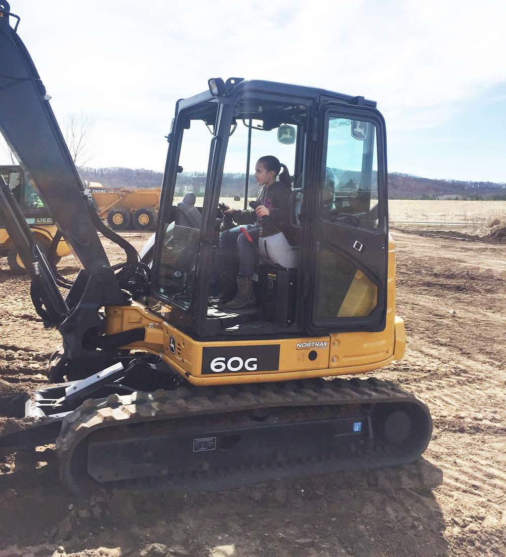 Aubrie Anderson operates a mini-excavator with ease. Aubrie's dad, Joe Anderson, joked that she could be on the payroll real soon with her skills.
