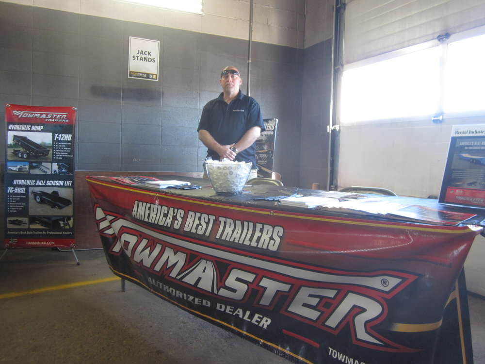 Russ Woelke, Towmaster regional sales manager, is ready to answer questions at the open house.