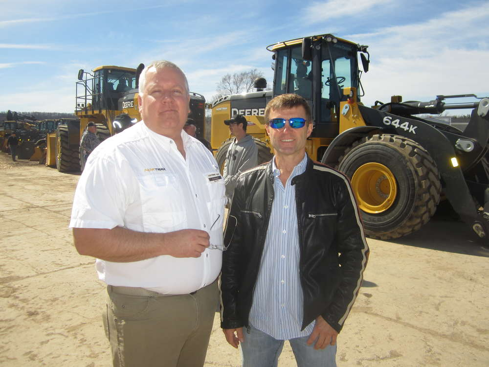 Eric Brosted (L) of Nortrax welcomes Terry Pecha, owner of A-1 Excavating, to the open house.
