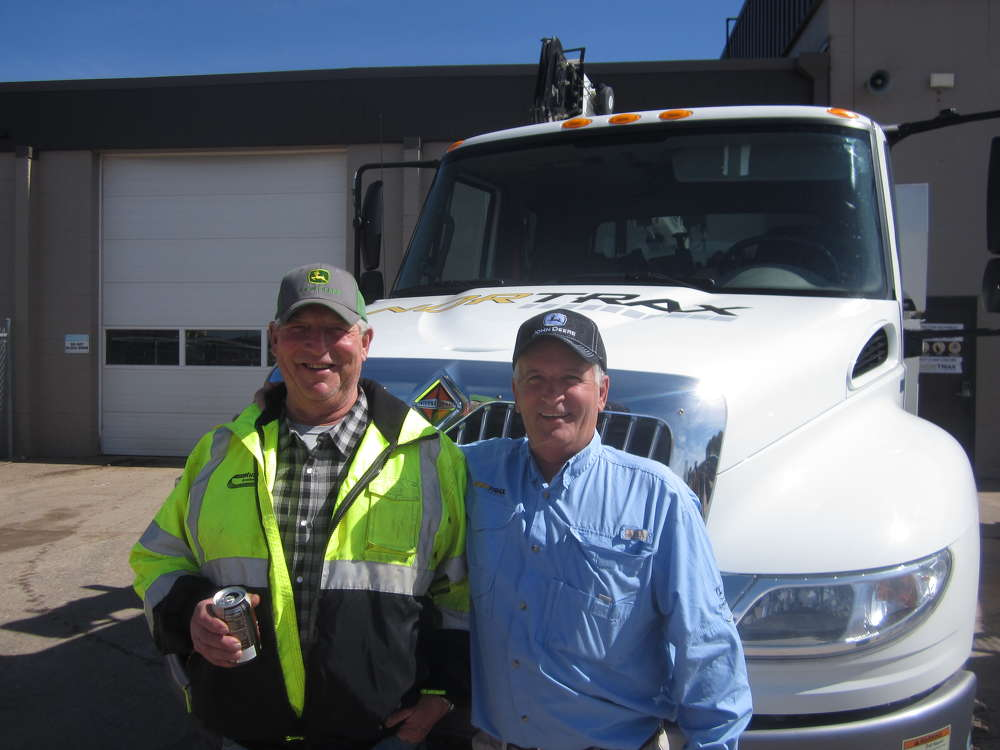 Rich Newman (L), retiree of Musson Brothers Inc., enjoys the open house with Dean Adsit, used equipment sales, Nortrax.