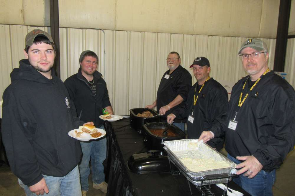 (L-R): Spencer and Dan Rohr, both of Rohr Services, are served up lunch by Jack Jones, Kenny Koprivec and Todd O'Neal, all of Rayco.