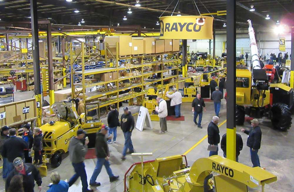 Attendees congregate inside Rayco's factory floor to take in the equipment and enjoy some lunch.