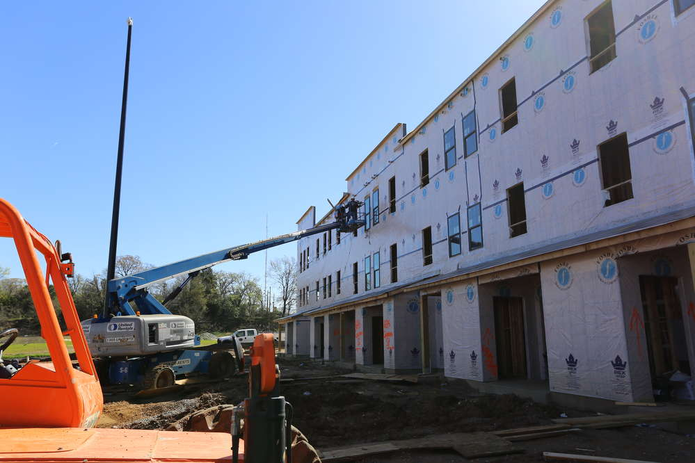 Molly Foshee photo The  first  phase  of  Columbus Square will  consist  of  80 market-rate  and  affordable apartments/town homes