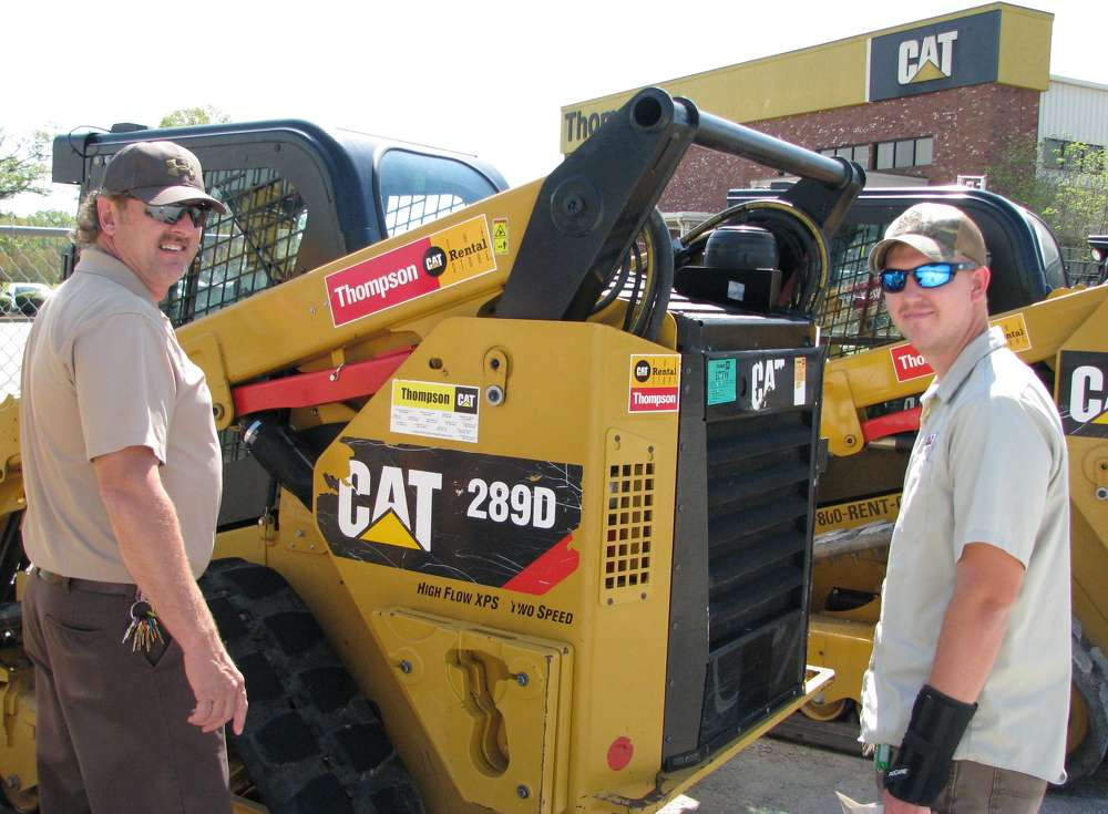 Greg Martin (L) and Cody Magness came over from Pickwick Landing State Park of the Tennessee State Parks Department to look over some of the machines available for rent at the CAT Rental Store.