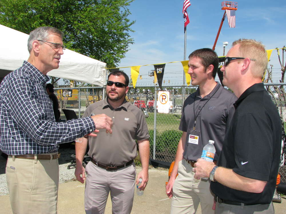 (L-R): Steve Lainhart, general manager of Thompson Power, Memphis, Tenn., talks to the Cat representatives who came out to the event from Nashville, including Matt Peterson, Cat GCI service rep; Jonathan Russell, Cat rental & used operations; and Adam Ackerman, Cat BCP sales and  service representative.