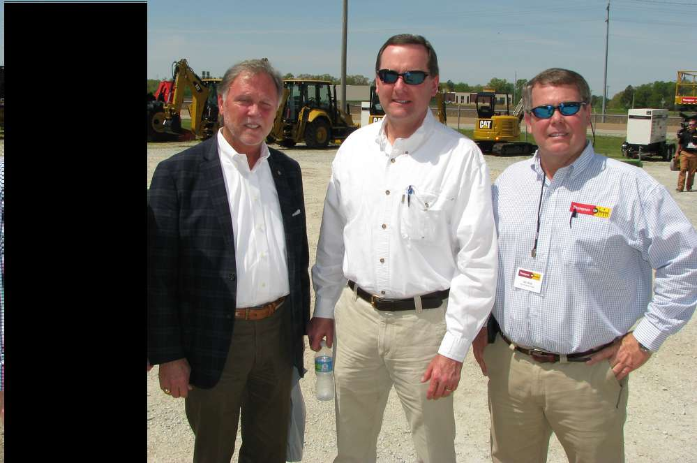(L-R): Jimmy Harris, mayor of Madison County, Tenn.; Bill Dement, president of Dement Construction, Jackson, Tenn.; and Del Reid, CAT Rental Store territory sales, discuss the construction projects under way in the Jackson area