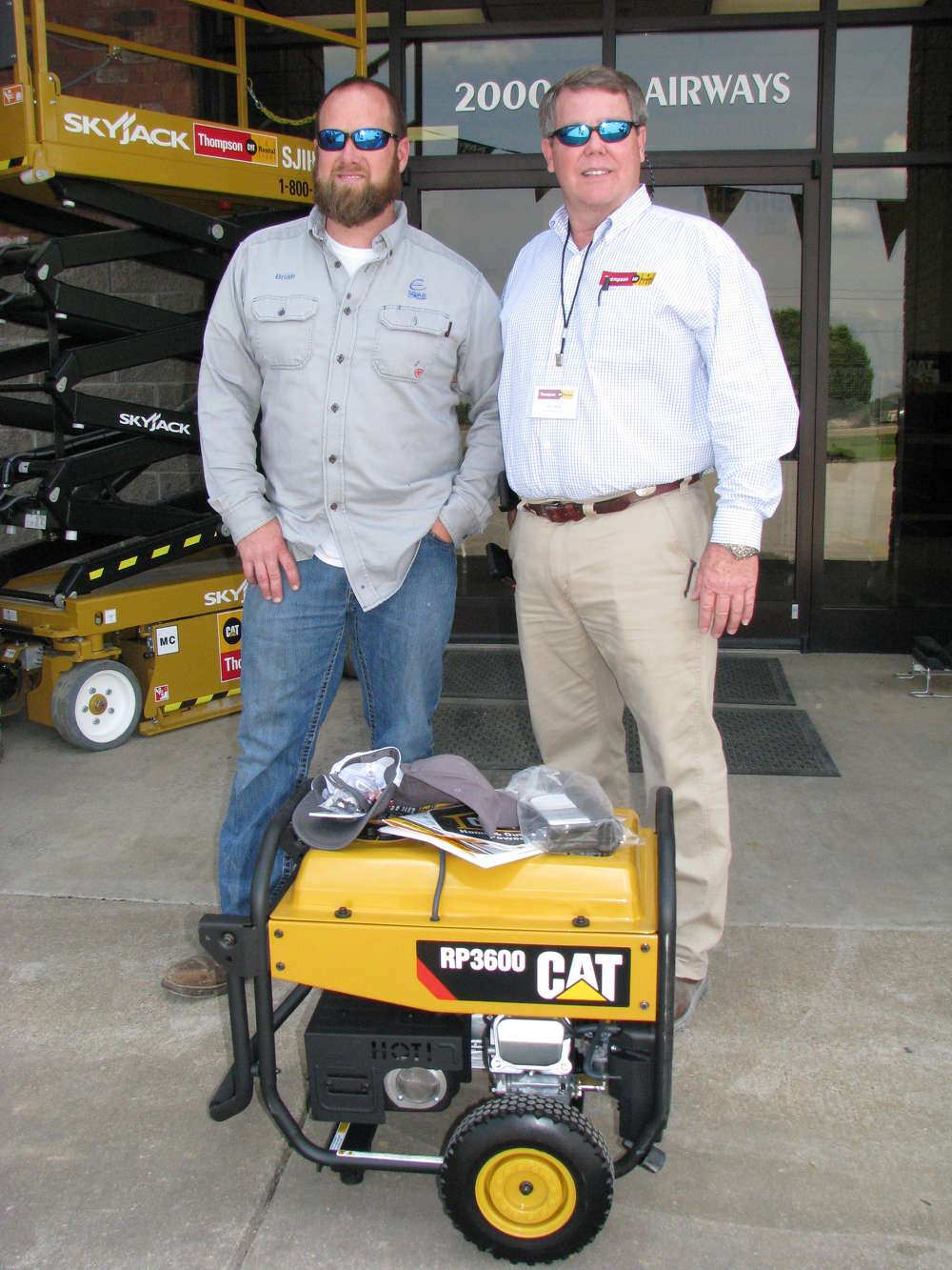 Brian Cornelison (L) of Jackson Energy Authority held the winning ticket for a Cat RP3600 generator, and received the prize from Del Reid, CAT Rental Store territory sales.