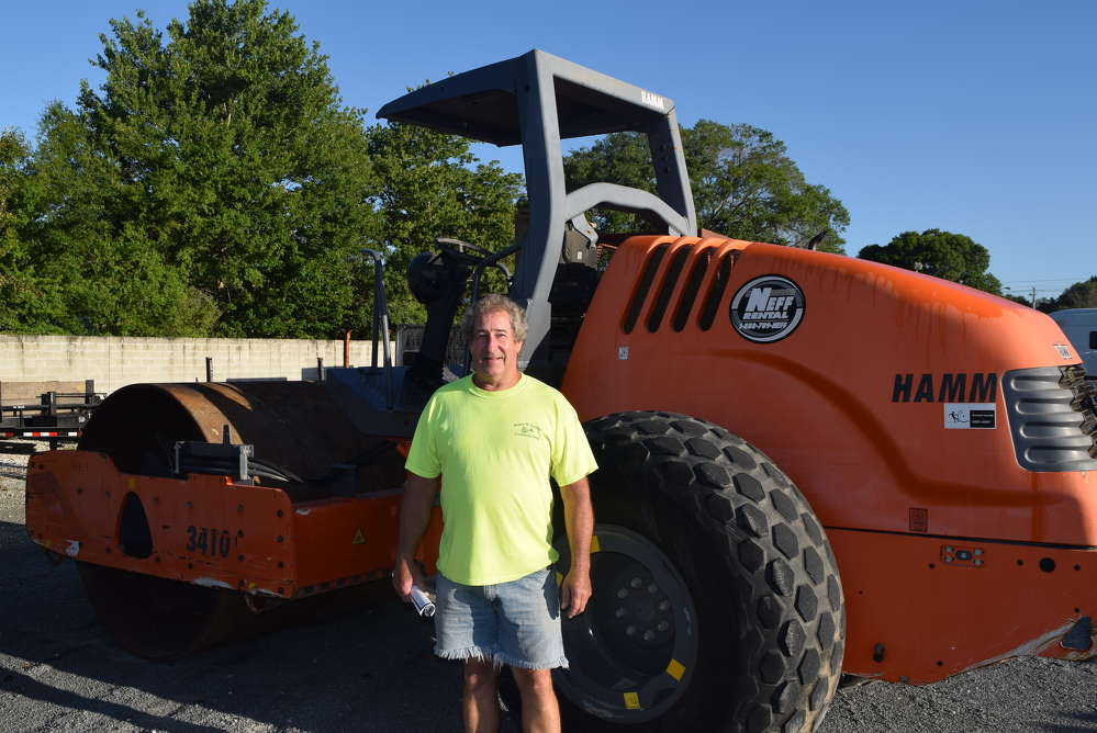 Roger Carter of Roger W. Carter Contracting LLC, Hannibal, N.Y., inspects this Hamm 3410 roller.