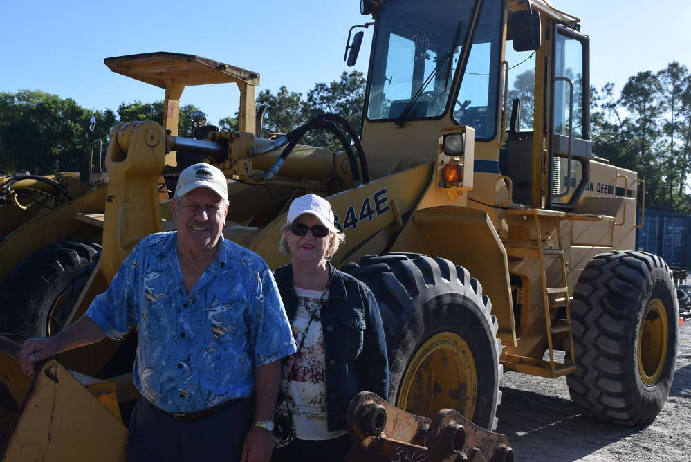 Richard and Gloria White, both of Richard White & Sons, North Stonington, Conn., enjoy the Florida weather while shopping for equipment.