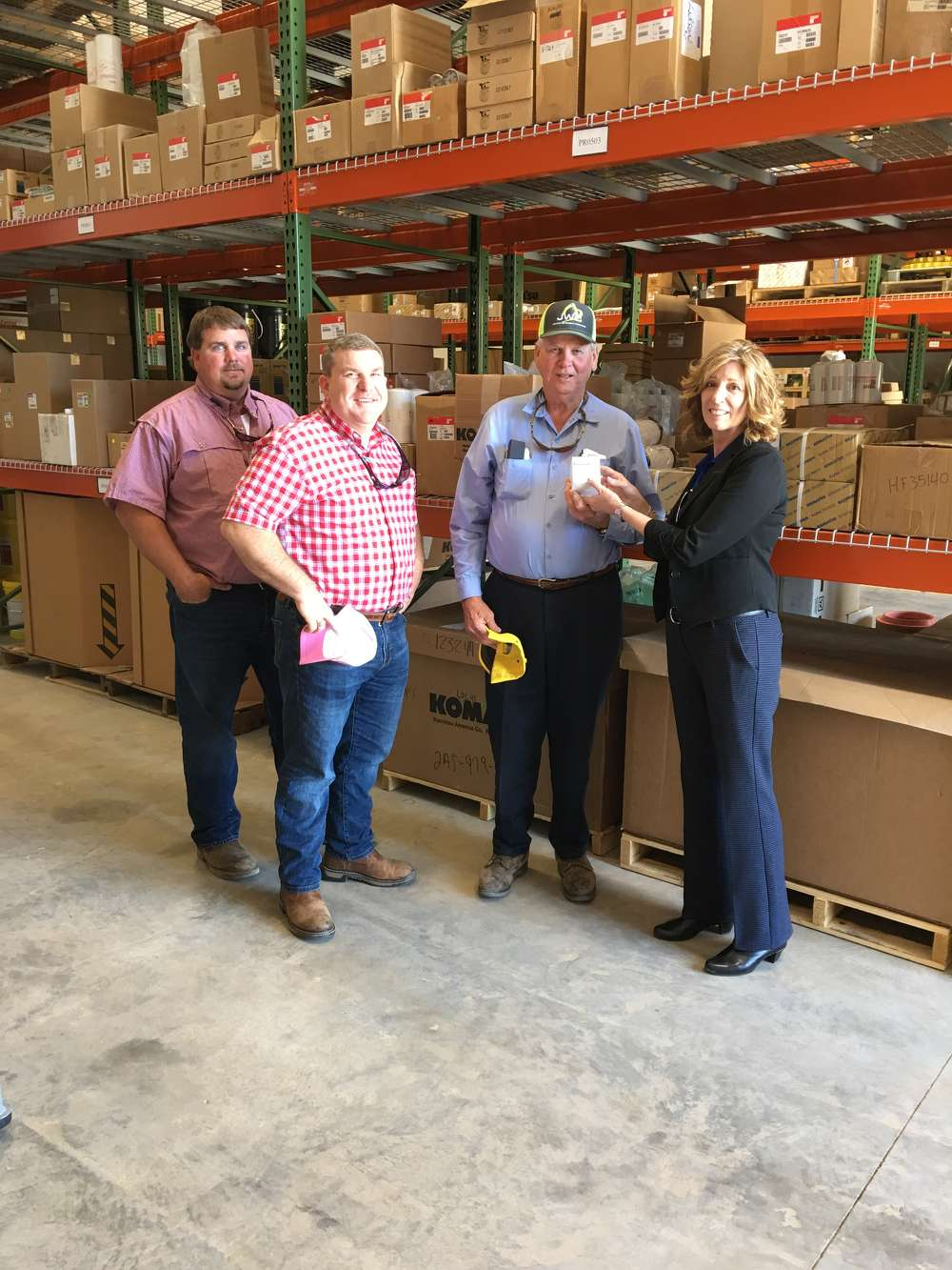 (L-R): James Gregory, Dan Hawkins and James White all with James White Construction in Mt Pleasant, S.C., participate in a guided tour of the parts facility from Lisa Chancey of Linder.