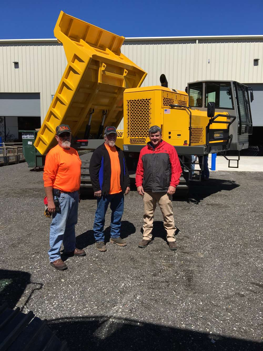 Charles Richardson (R) of Linder goes over the Terramac RT14R, a 14-ton (12.7 t) rotating bed crawler carrier with Barry McKenzie (L) of Kapstone Paper, Charleston, S.C., and Ricky Huneycutt of H&J Contracting in Charleston.