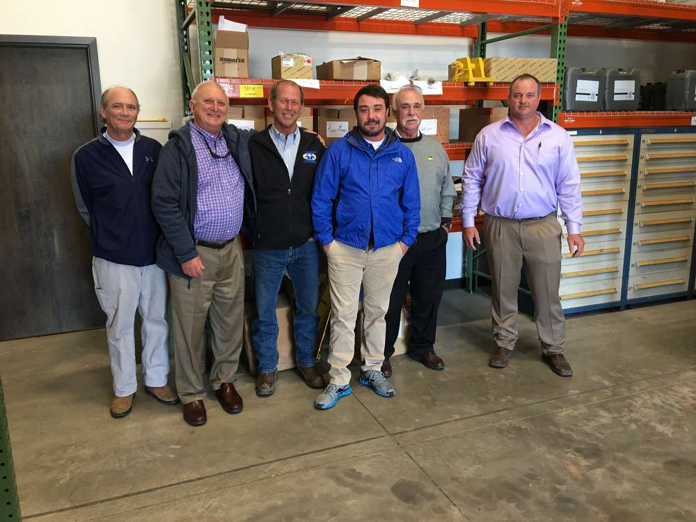 Sam Light (Far Right) of Linder gives a tour of the large parts warehouse to (L-R) Claude Blanchard and Kenneth Holseberg, both of Gulf Stream Construction, in Charleston, S.C.; Trey Banks, Banks Construction in North Charleston, S.C.; and Rob and Bob Welborn of Welborn Trucking in Monks Corner, S.C.