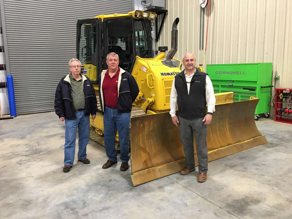 Andy Chapman (R) of Linder goes over the  features and benefits of the Komatsu D39pxi intelligent dozer with (L-R) Mike Lingrel and Carl Schultz, both of Sanders Brothers Construction in North Charleston, S.C.