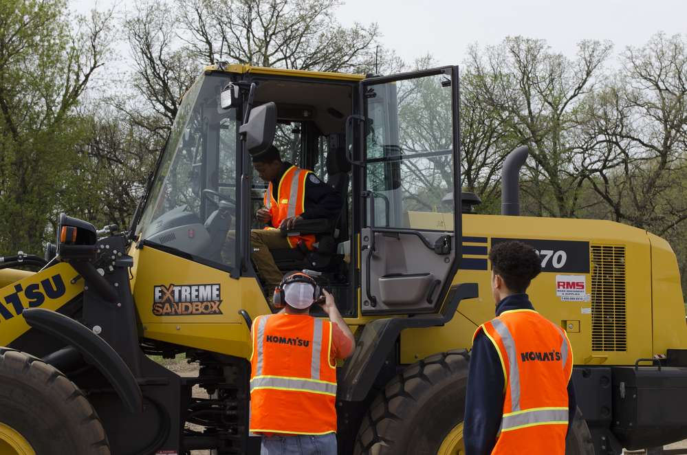 Forty high school students from Warren County High School in Warrenton, NC, took a 20-hour bus ride to Hastings, MN, to learn about job prospects in the construction industry and how to operate Komatsu equipment.