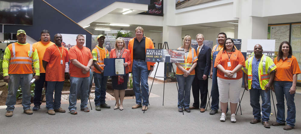 Gov. Mary Fallin presented a proclamation at the April 10 meeting of the Oklahoma Transportation Commission declaring April 3-May 3 Work Zone Awareness Month and met with Oklahoma Department of Transportation workers. (L-R) are Dural Jackson, Division Four; Richard O'Neal, Division Four; Craig Williams, Division Four; Shane Jardot, Division Four; Tim Vester, Division Four; Gov. Fallin, Rick Howland, Edmond Residency; Carolyn Flores, Pottawatomie County; Mike Patterson, ODOT executive director.