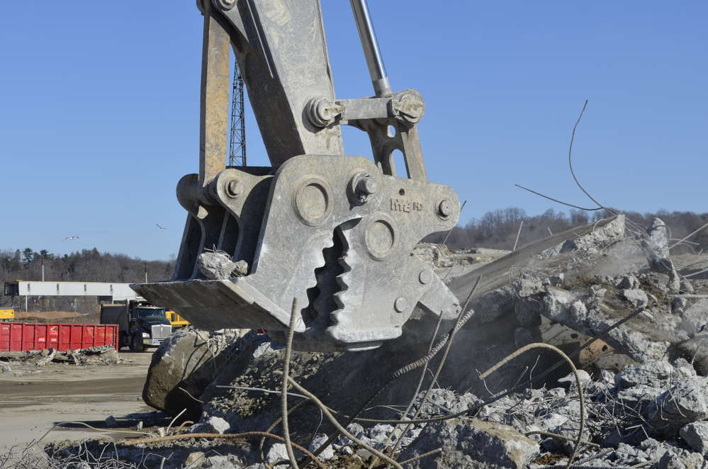 The patented ripper attachment on the NYE pulverizer is used to maneuver concrete slabs
