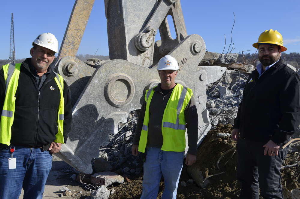 (L-R) with the NYE pulverizer are: Stephen Scherrer, logistics manager; David Buzzeo, superintendent; and Gabe Guimond, National Attachments vice president of demolition products.