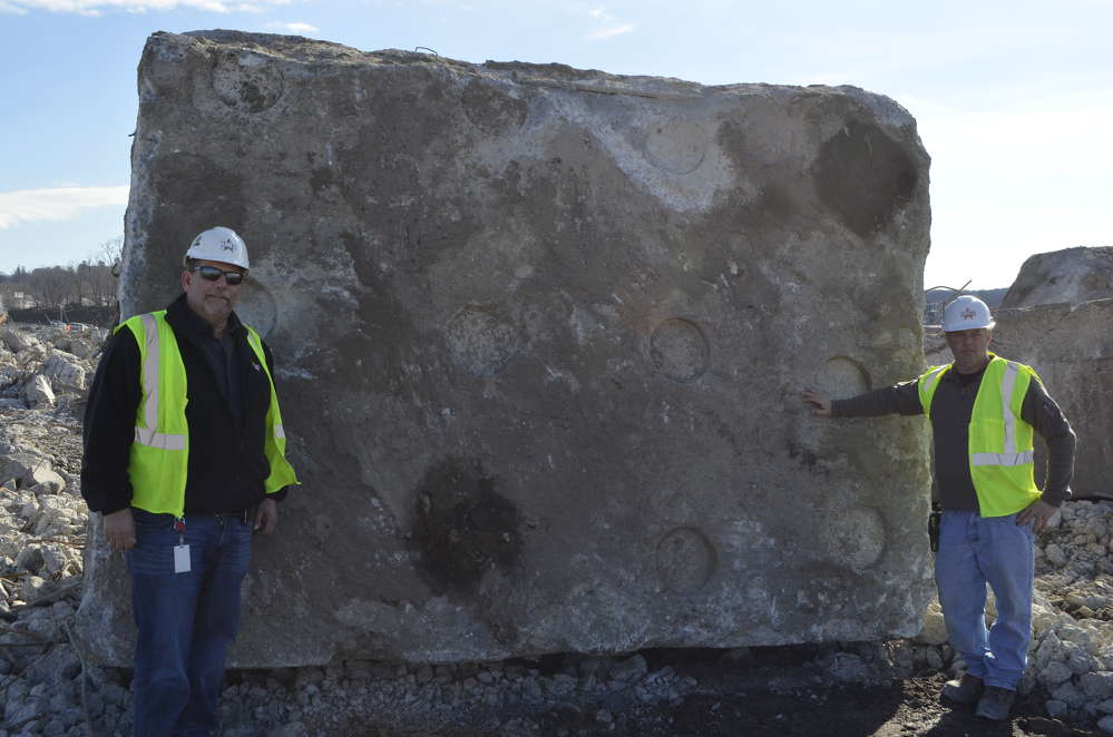 Stephen Scherrer (L), logistics manager, and David Buzzeo, superintendent, standing with a typical chunk of concrete