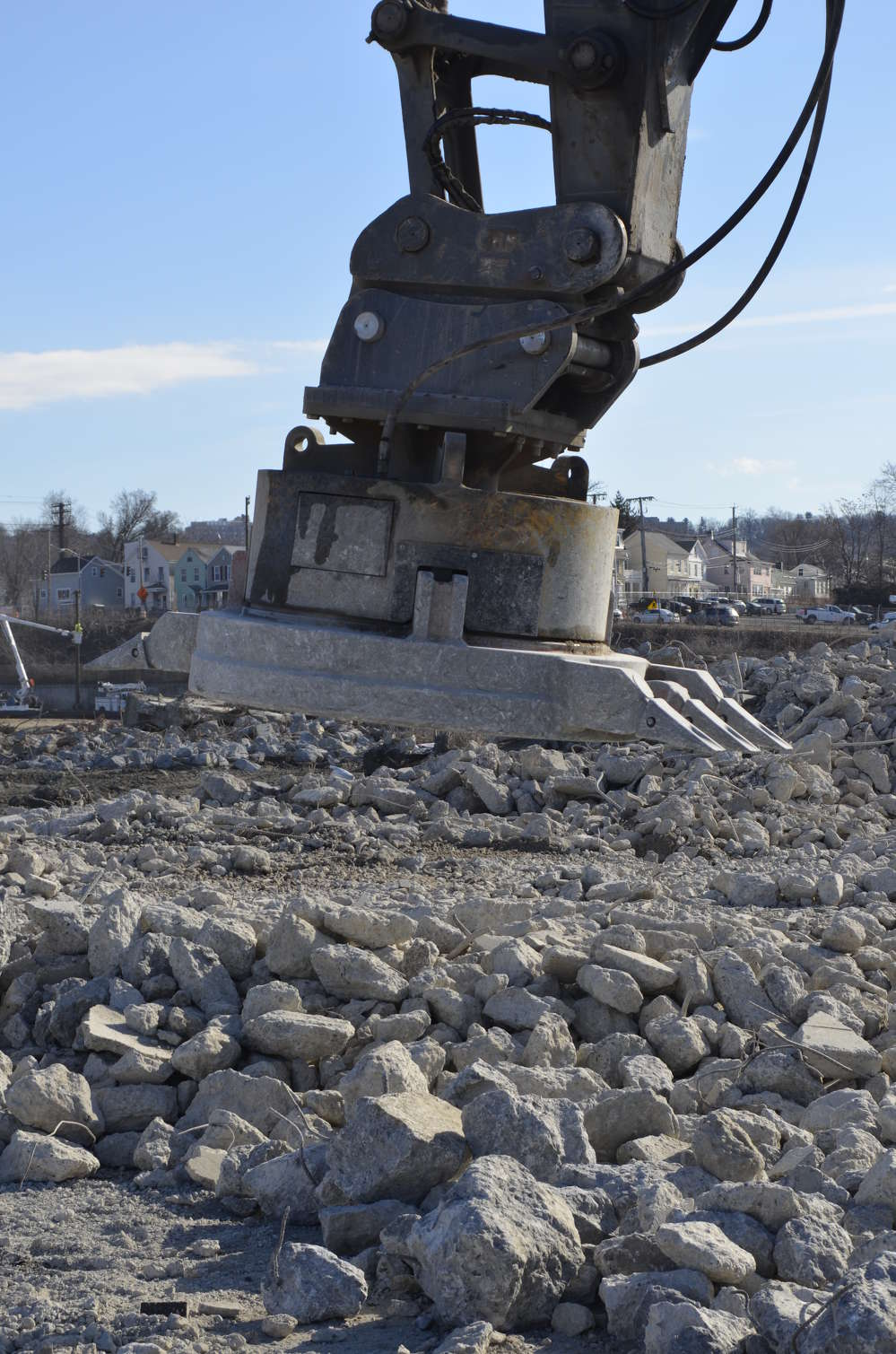 This Moley hydraulic magnet was purchased from National Attachments.  The claw teeth on each side allow the magnet to scrape through concrete rubble, exposing the rebar.