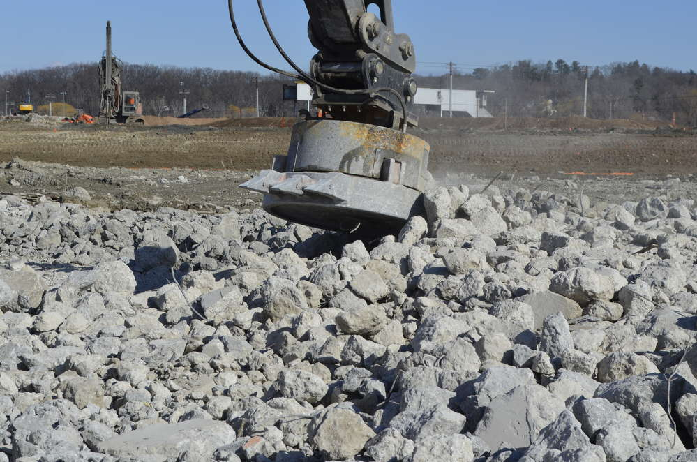 The Moley hydraulic magnet's teeth are used to push concrete rubble away as its magnets separate out the rebar.