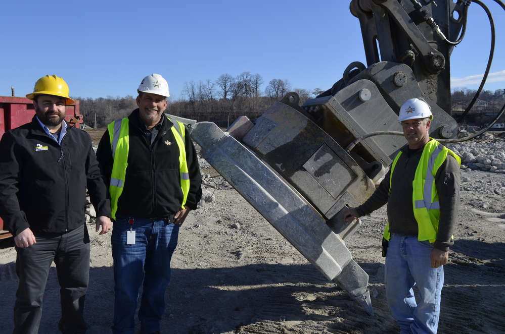 (L-R) with the Moley magnet are: Gabe Guimond, National Attachments vice president of demolition products; Steve Scherrer, logistics manager; and David Buzzeo, superintendent.