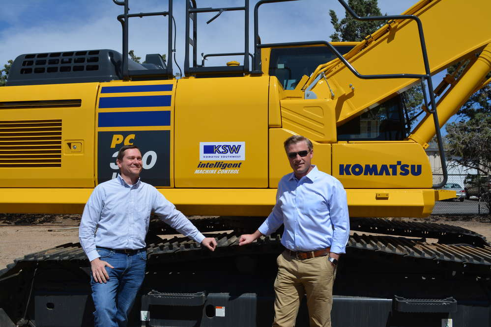 Randy Agee (L), general manager of product support, and Grant Adams, president, show off one of the Komatsu PC 360s in their ever-growing inventory.
