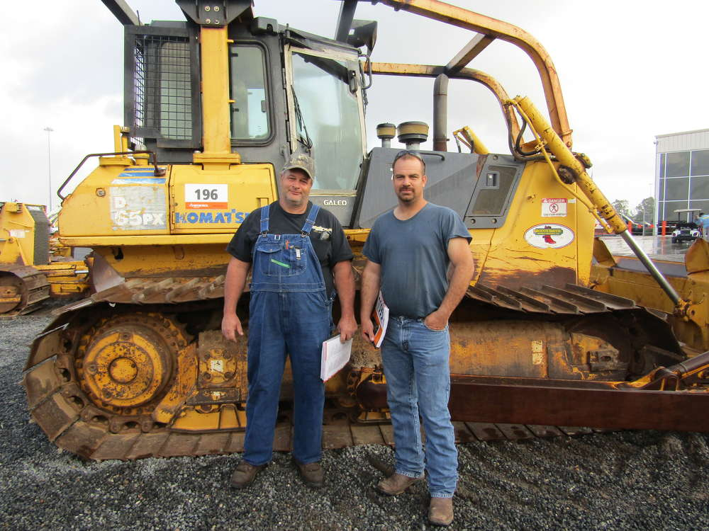 Missouri farmers David Taylor (L) and Barend Jones were shopping dozers and took a long look at this Komatsu D65PX.