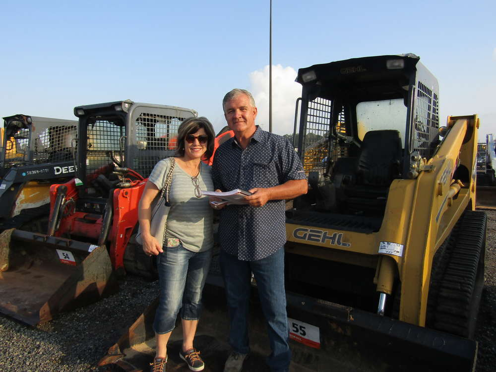Dozens of skid steers were up for sale, including this Gehl machine, which captured the attention of Blaine and Jo Devillier, owners of Devillier Truck Sales in Lake Charles, La.