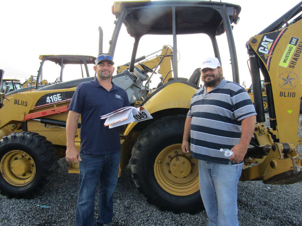 Backhoe loaders, like this Cat 416E, brought Quest Utility Construction's Roman Solarczyk (L) and Mike Moreno to Houston from San Antonio.