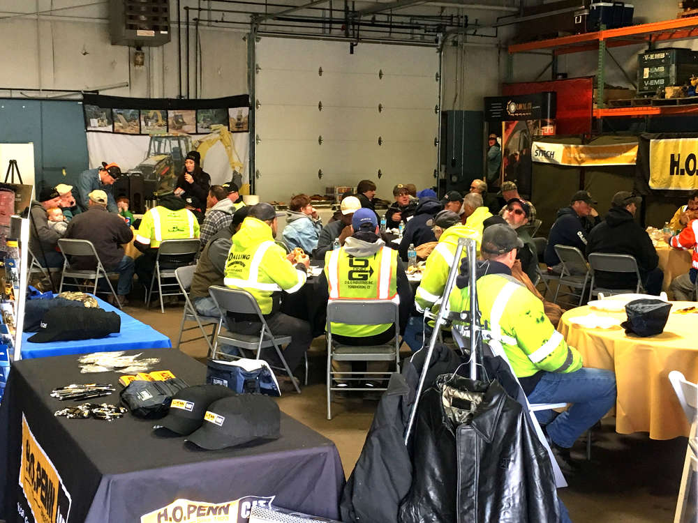 Guests take a well-deserved break from the cold and enjoy a filling lunch before heading back out to the demo area.