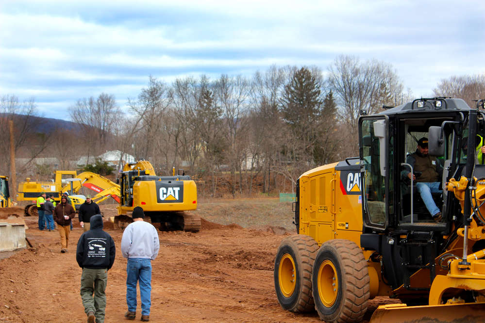 Guests move on to check out the latest technology on the Cat 323F excavator after a turn on the Cat 12M motorgrader.